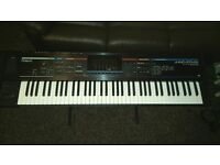 Roland Juno Stage with stand and wheeled gig bag