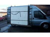 side rack for ford transit mk7 lwb carries two garage doors.