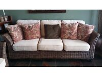 dark rattan 3 seater and chair with buttermilk upholstery
