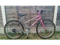Ladies pink and grey mountain bike