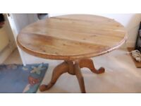 Antique pine round kitchen or dining table, folding sections. Could do with sanding & sealing/paint