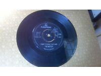 Original vintage pair of Beatles vinyl 45s in good condition,