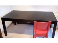 black darkwood table and chairs