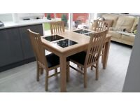 Dinning table with four chairs, very clean. £120 only.