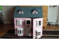 Playhouse and a cot for dolls for sale