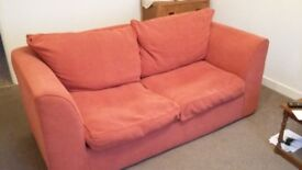 Orange/ terracotta sofa bed for sale.