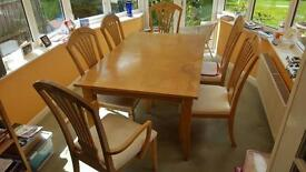 Wooden table with extendable leaf. 8 x chairs.