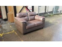 three seater two seater sofa brown leather god condition can deliver