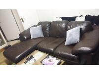 Real leather brown sofa.