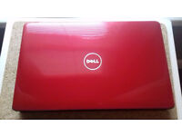 Red , Dell Inspiron 1545 Laptop,Runs Same As Brand NEW.
