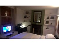 deluxe room with ensuite in dog friendly house close to 10 mins walk to amex, hospital and seafront