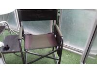 Fishing chair with fold in table and side pockets