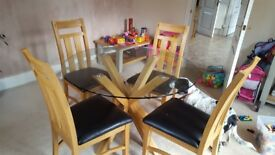 Oak dining table with glass top with 5 chairs