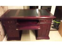Antique style mahogany pedestal leather topped writing desk and Chesterfield office chair