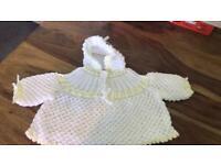 Hand knitted baby girl lemon and white cardigan