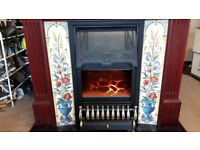 Electric fire with tiled surround fireplace