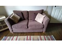 Two seater brown sofa with cushions x 2
