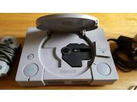 Playstation 1 with games and leads