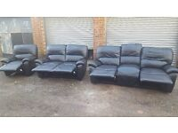 Lovely black leather sofa suite. 3+2+1. all recliners,originally from DFS. a bit of wear.can deliver