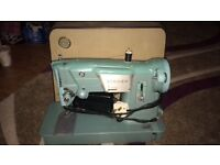 Vintage Singer electric sewing machine with sturdy carry case