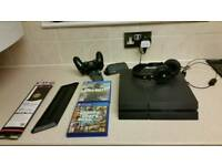 Ps4 with 2 games headphones key pad and side stand