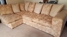 Large gold corner sofa with pull out double bed and pouffe.
