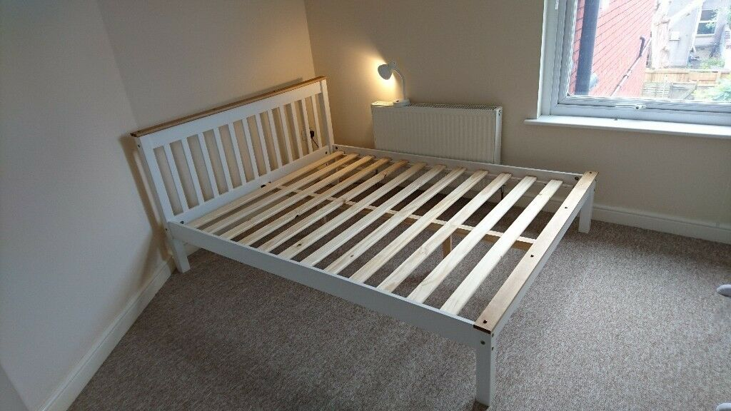 King Size Solid Wood Bed (As Newin Knowle, Bristol - King sized solid wood bed with elegant white finish (matress not included). Immaculate condition only 2 months old. Our new bedroom is going to be too small for this lovely bed. Dimensions 200cm L x 150cm W. Ready for collection