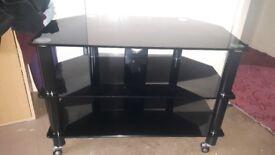 Black glass tv unit on wheels