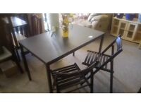 Ikea black ash table & 2 folding chairs £25. CHEAP local DELIVERY Stalybridge SK15 3DN.