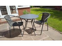 Metal garden table with two chairs