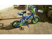 Boys blue first bike and stabilisers