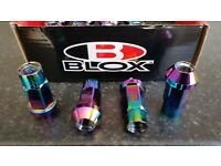 Blox neo chrome alloy wheel tuner nuts.