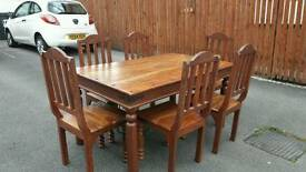 Large solid wood farmhouse table and 6 chairs