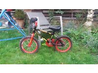 Childrens bike suitable for children aged 3 to 6 without stabblizers. Red and black in colour.