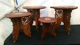 Four hand carved tables