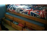 Single captains bed with pull out trundle & storage