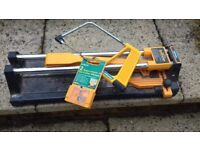 Tile cutter for ceramic tiles with saw and 2 replacement tile cutter wheels