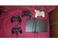 Playstation 2 with 4 controllers and games