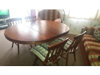 solid wood dining table to seat 4-8 people with leaves thats fold out and 5 solid chairs with covers