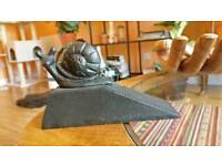 Snail door stopper or bookend