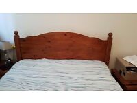 Wooden double bed, mattress, mattress cover, mattress topper and bed side drawers x2,