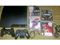 Sony Playstation 3 slim console , 2 controllers . 4 games (ps3)