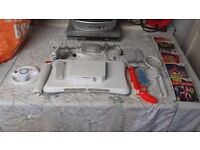 Wii console with 5 games and wii board etc