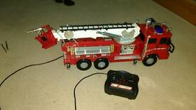 "Remote control (18"") fire engine with real water squirting hose"