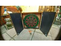 Dartboard and cabinet