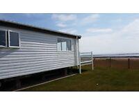 -LODGE ON THE BEACH-SUNNING VIEWS OF THE SOLAWAY COAST,near dumfries,kippford,penrith,keswick
