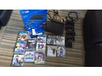 PS3 500GB with box, 4 wireless controllers and 13 games