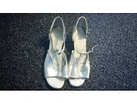 A pair of silver dance shoes