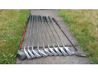 Full set of Wilson cavity back irons & Mizuno bag. Also included a putter, driver, trolley & balls