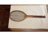 vintage wooden fish tail tennis racquet and press.